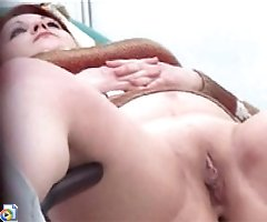 Voyeur video showing hot redhead in gyno's office