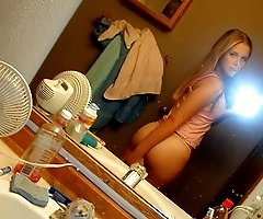 Doll admiring her hot body near the mirror