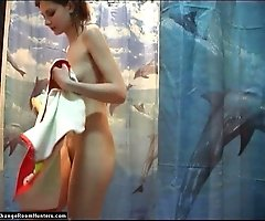Young redhead caught exposing tits in a shower